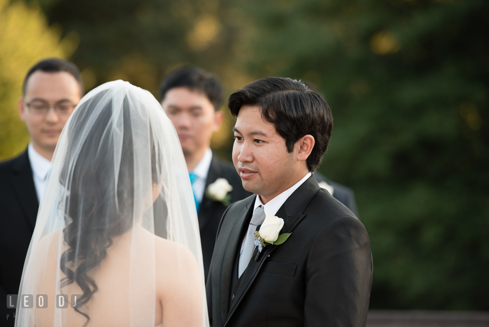 Reston Virginia Wedding Groom reciting vow to Bride photo by Leo Dj Photography