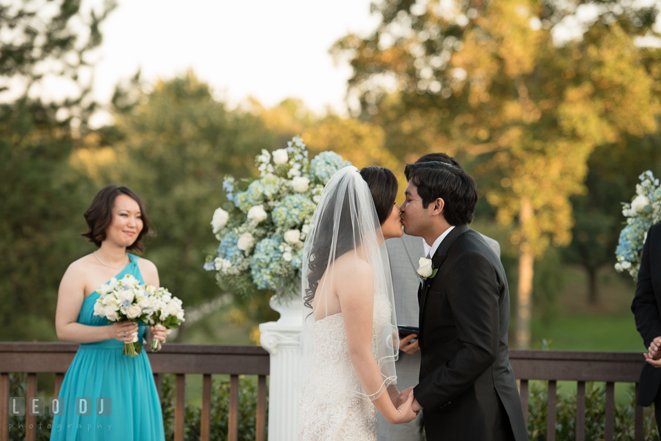 Reston Virginia Wedding Groom kissing Bride during ceremony photo by Leo Dj Photography