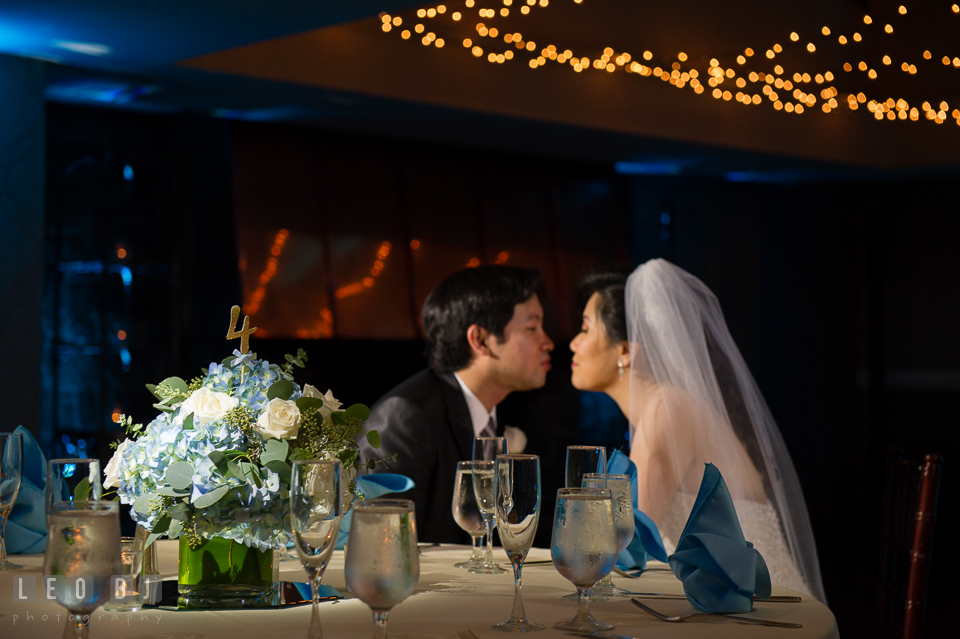 Hidden Creek Country Club Bride and Groom almost kissing by the dining table photo by Leo Dj Photography