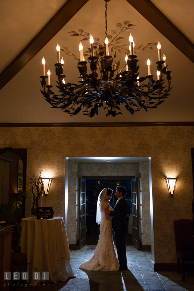 Hidden Creek Country Club Bride and Groom under chandelier silhouette photo by Leo Dj Photography
