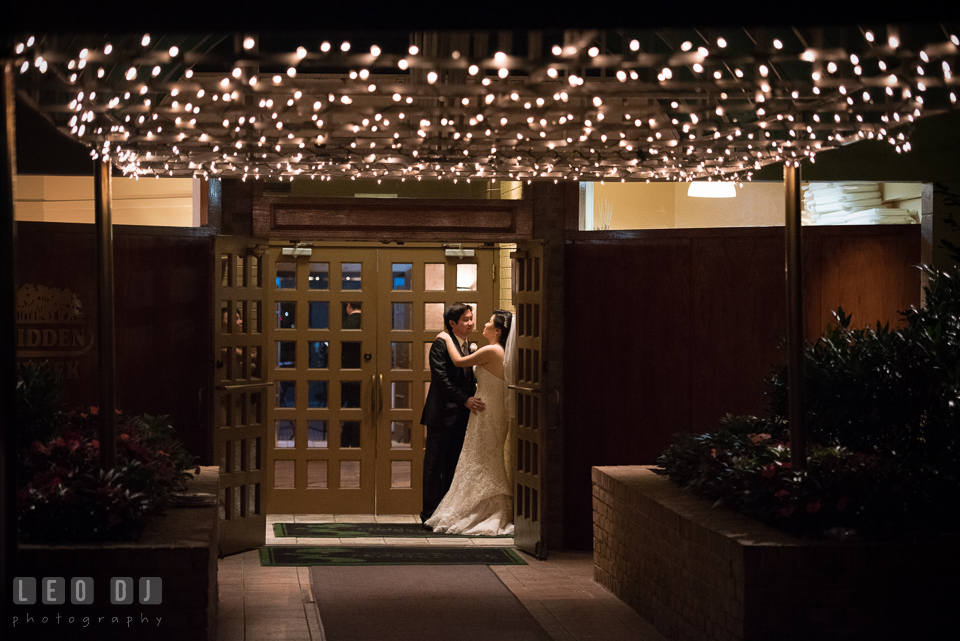 Hidden Creek Country Club Bride and Groom hugging under string of lights photo by Leo Dj Photography