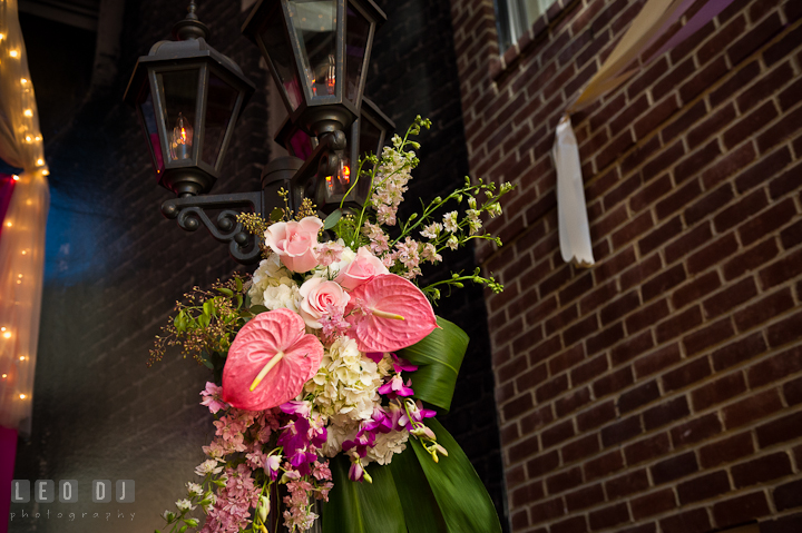 Pink rose, purple orchid and white hydrangea on lamp post. Historic Inns of Annapolis wedding bridal fair photos at Calvert House by photographers of Leo Dj Photography. http://leodjphoto.com