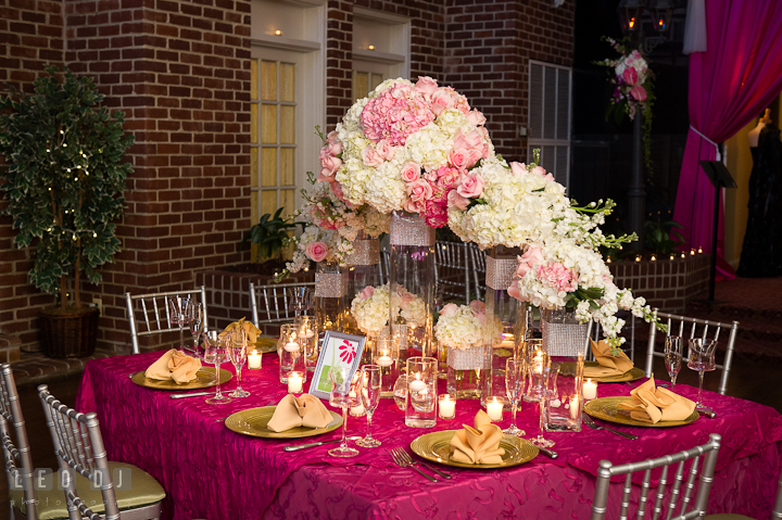 Table centerpiece decorations with white and pink hydrangea flower and roses. Historic Inns of Annapolis wedding bridal fair photos at Calvert House by photographers of Leo Dj Photography. http://leodjphoto.com