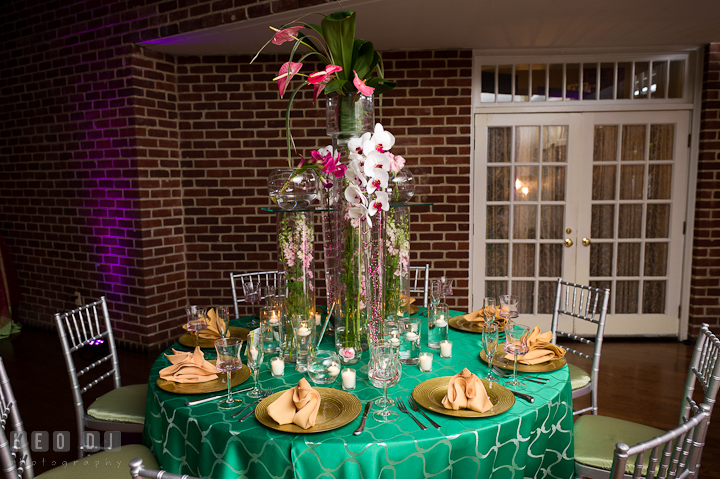 Table setup with tall centerpiece with white and purple orchids. Historic Inns of Annapolis wedding bridal fair photos at Calvert House by photographers of Leo Dj Photography. http://leodjphoto.com