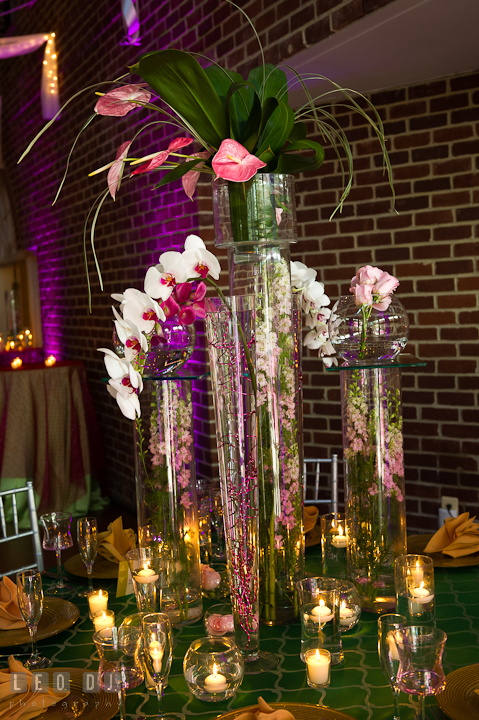 Tall vase centerpieces with white/purple orchids and pink/while flowers. Historic Inns of Annapolis wedding bridal fair photos at Calvert House by photographers of Leo Dj Photography. http://leodjphoto.com