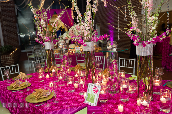 Tall centerpieces with white, pink and purple floral set with silver and transparent beads. Historic Inns of Annapolis wedding bridal fair photos at Calvert House by photographers of Leo Dj Photography. http://leodjphoto.com