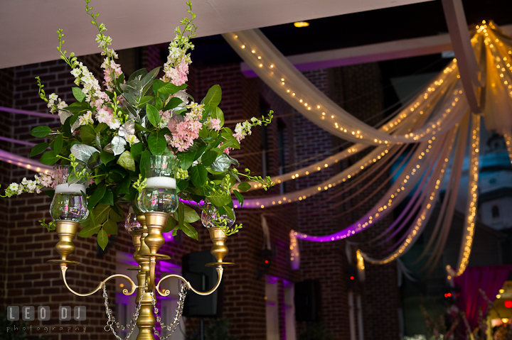 Table centerpiece with golden candlestick with tea lights and flowers. Historic Inns of Annapolis wedding bridal fair photos at Calvert House by photographers of Leo Dj Photography. http://leodjphoto.com