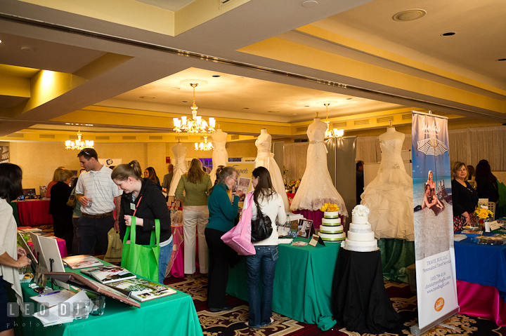 Guests visiting vendor table booths . Historic Inns of Annapolis wedding bridal fair photos at Calvert House by photographers of Leo Dj Photography. http://leodjphoto.com