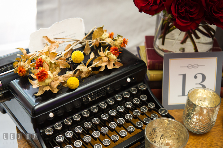Old typewriter and dried flowers decor. Historic Inns of Annapolis wedding bridal fair photos at Calvert House by photographers of Leo Dj Photography. http://leodjphoto.com