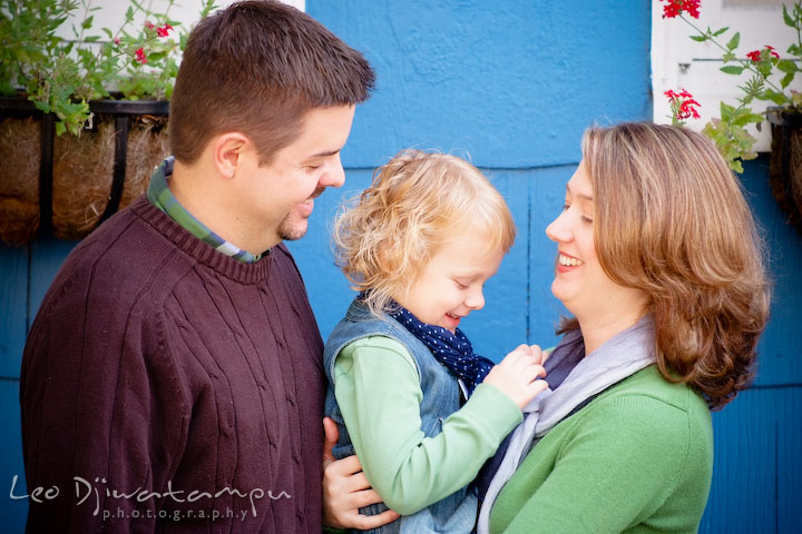 Mother, father and daughter laughing together. Annapolis Maryland candid lifestyle family portrait photography