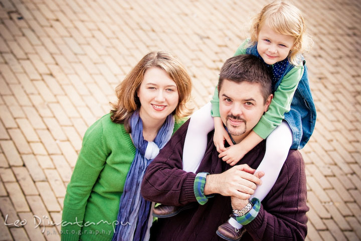 Daughter carried by Dad on shoulder. Mom smiling. Annapolis Maryland candid lifestyle family portrait photography