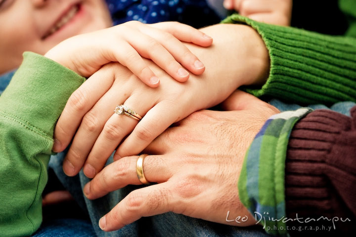Mom, Dan and girl holding hands, showing wedding band and engagement ring. Annapolis Maryland candid lifestyle family portrait photography