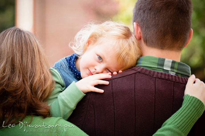 Daughter laying head on Dad's shoulder. Annapolis Maryland candid lifestyle family portrait photography