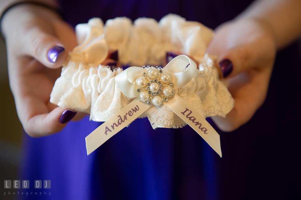 Garter decorated with Bride and Groom's name. Kent Island Maryland Chesapeake Bay Beach Club wedding photo, by wedding photographers of Leo Dj Photography. http://leodjphoto.com