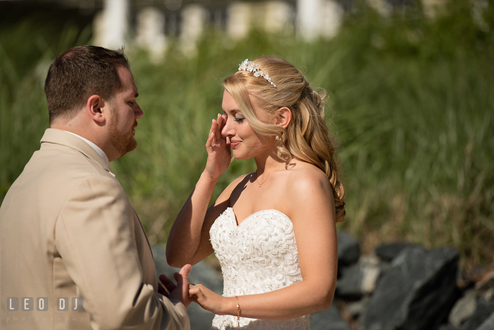 Bride wiping off tears during first glance with Groom. Kent Island Maryland Chesapeake Bay Beach Club wedding photo, by wedding photographers of Leo Dj Photography. http://leodjphoto.com