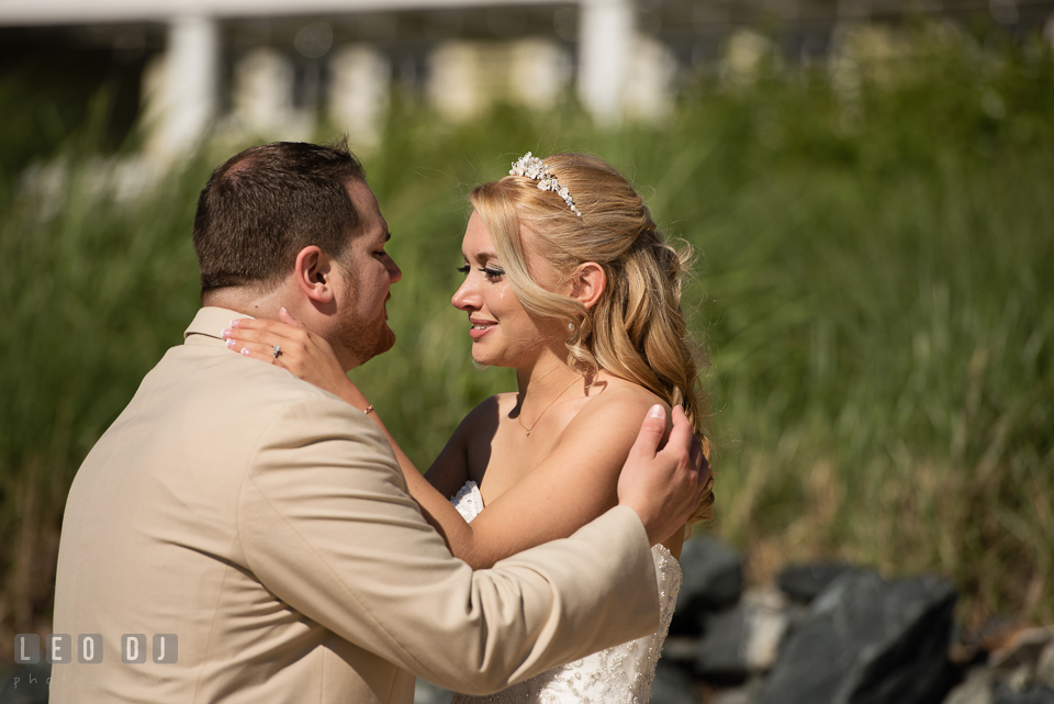Bride and Groom embracing each other during their first look. Kent Island Maryland Chesapeake Bay Beach Club wedding photo, by wedding photographers of Leo Dj Photography. http://leodjphoto.com