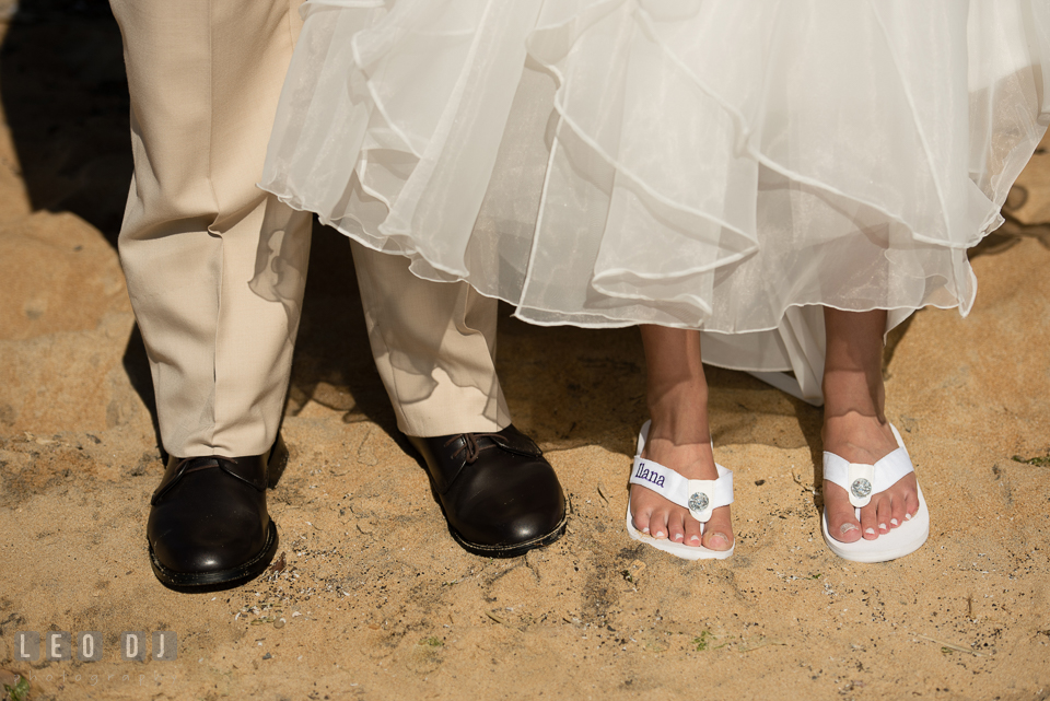 Bride and Groom on the Beach showing their shoes and sandals. Kent Island Maryland Chesapeake Bay Beach Club wedding photo, by wedding photographers of Leo Dj Photography. http://leodjphoto.com