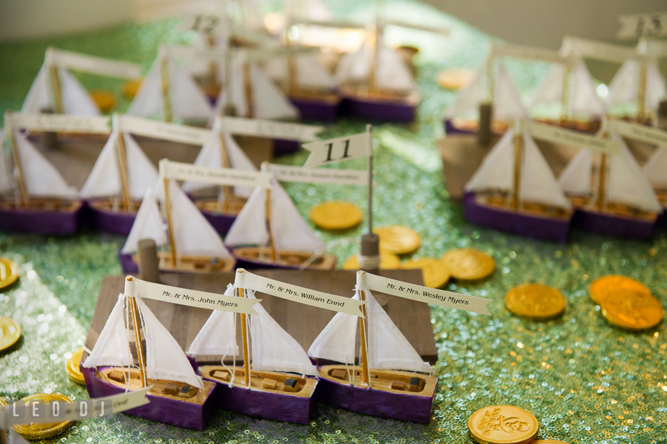 Small sailboats with guest names for the table assignments. Kent Island Maryland Chesapeake Bay Beach Club wedding photo, by wedding photographers of Leo Dj Photography. http://leodjphoto.com