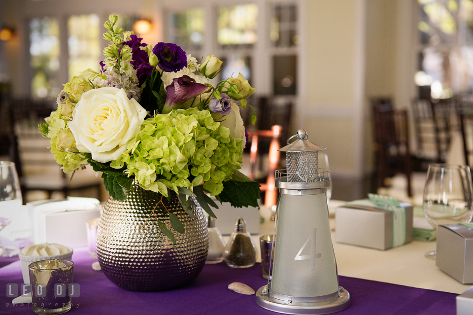 Beautiful flower centerpiece from florist My Flower Box Events and silver lighthouse candle holder with table numbers. Kent Island Maryland Chesapeake Bay Beach Club wedding photo, by wedding photographers of Leo Dj Photography. http://leodjphoto.com