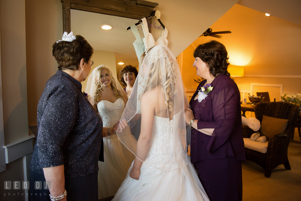 Mother of Bride and Grandmother help put on veil for Bride. Kent Island Maryland Chesapeake Bay Beach Club wedding photo, by wedding photographers of Leo Dj Photography. http://leodjphoto.com