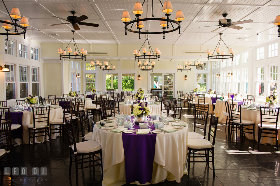 Tavern on the Bay dining room table arrangements. Kent Island Maryland Chesapeake Bay Beach Club wedding photo, by wedding photographers of Leo Dj Photography. http://leodjphoto.com
