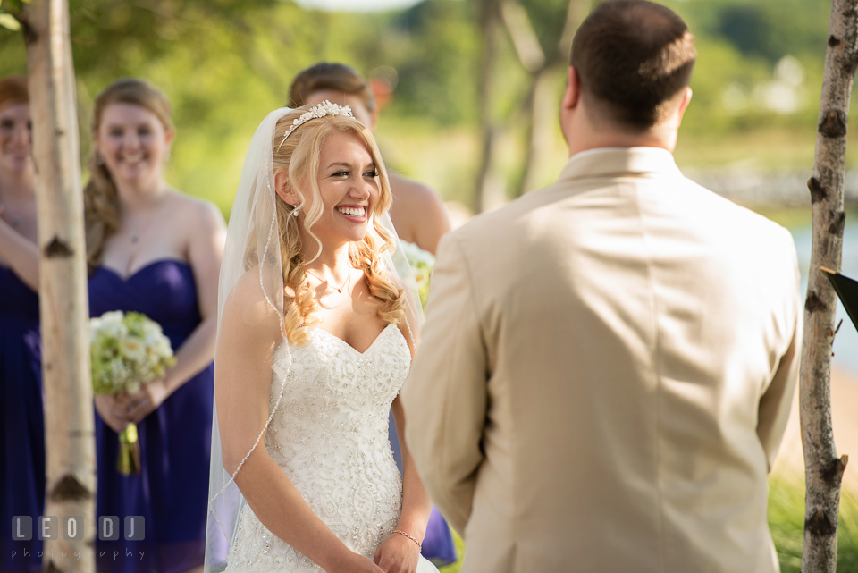 Bride smiling ear to ear during the ceremony. Kent Island Maryland Chesapeake Bay Beach Club wedding photo, by wedding photographers of Leo Dj Photography. http://leodjphoto.com
