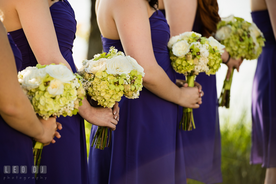 Bridesmaids and Maid of Honor holding their bouquets from florist My Flower Box Events. Kent Island Maryland Chesapeake Bay Beach Club wedding photo, by wedding photographers of Leo Dj Photography. http://leodjphoto.com