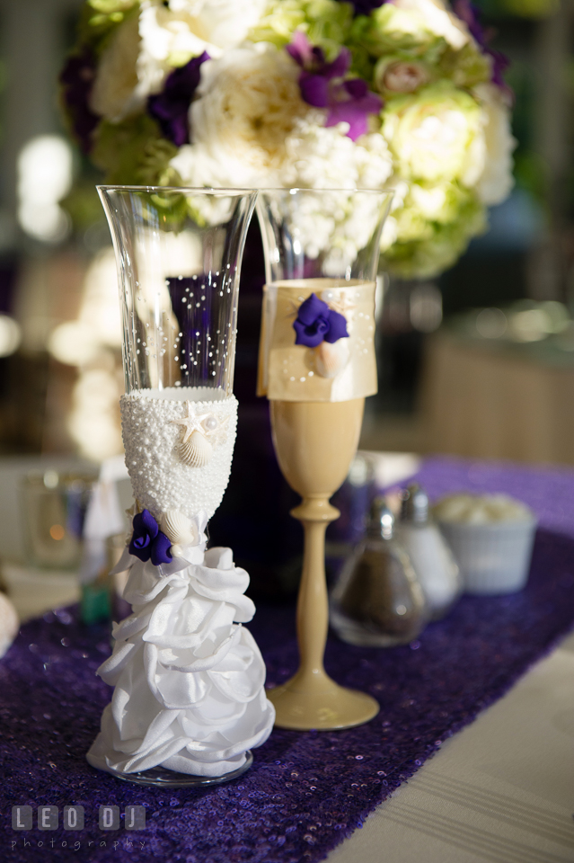 Custom made champagne glasses by AlisaKarol from Etsy. Kent Island Maryland Chesapeake Bay Beach Club wedding photo, by wedding photographers of Leo Dj Photography. http://leodjphoto.com