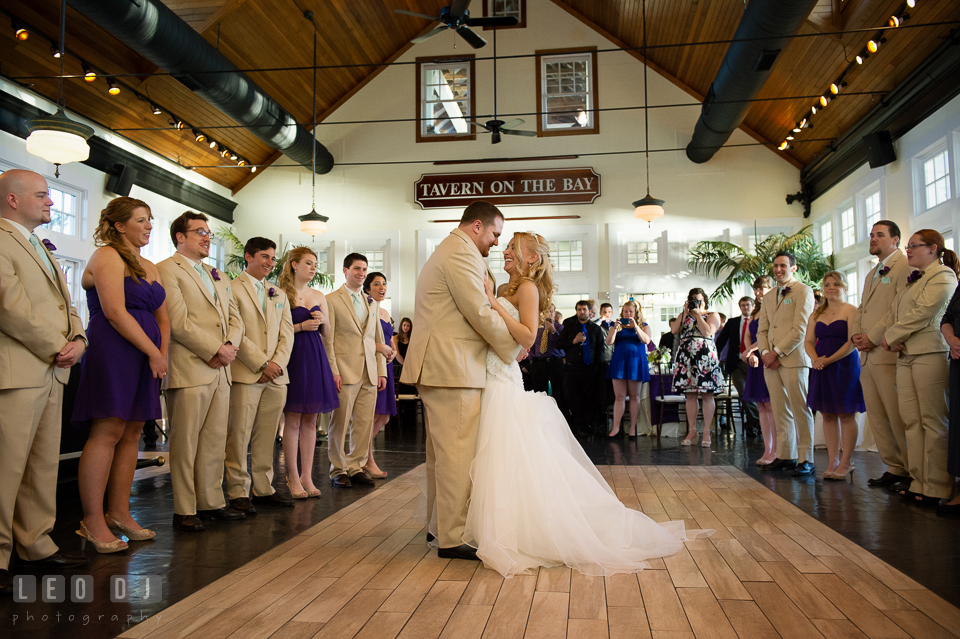 Guests looking at Bride and Groom doing first dance in the Tavern on the Bay room. Kent Island Maryland Chesapeake Bay Beach Club wedding photo, by wedding photographers of Leo Dj Photography. http://leodjphoto.com