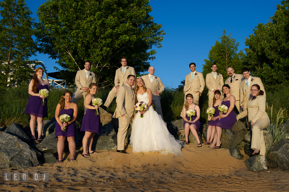 Bride and Groom with the whole wedding party including the Best Man, Maid of Honor, Groomsmen and Bridesmaids on the beach. Kent Island Maryland Chesapeake Bay Beach Club wedding photo, by wedding photographers of Leo Dj Photography. http://leodjphoto.com