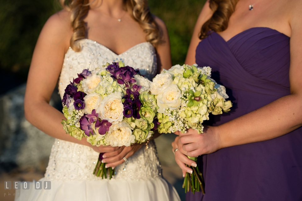 Bride and Maid of Honor holding gorgeous bouquet by florist My Flower Box Events. Kent Island Maryland Chesapeake Bay Beach Club wedding photo, by wedding photographers of Leo Dj Photography. http://leodjphoto.com