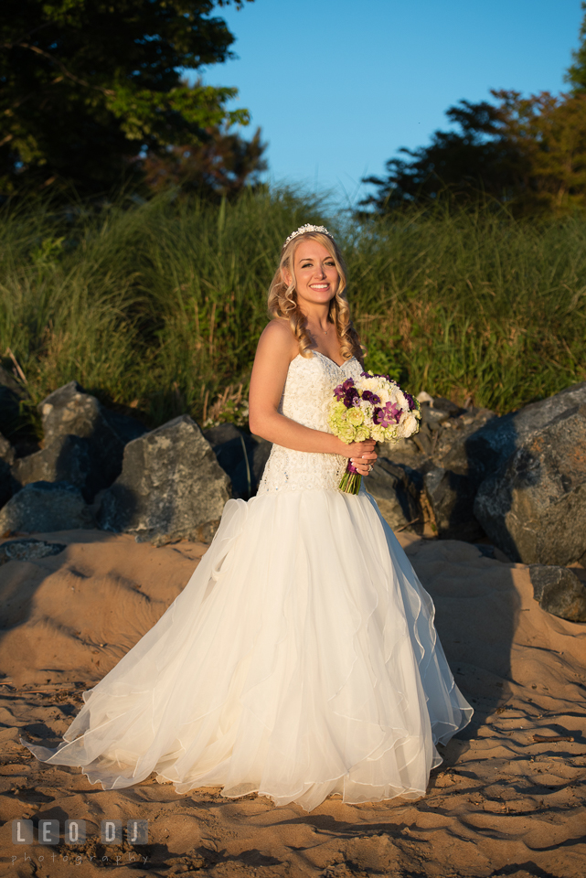 Ilana posing on the beach with her Bride's bouquet from My Flower Box Events. Kent Island Maryland Chesapeake Bay Beach Club wedding photo, by wedding photographers of Leo Dj Photography. http://leodjphoto.com