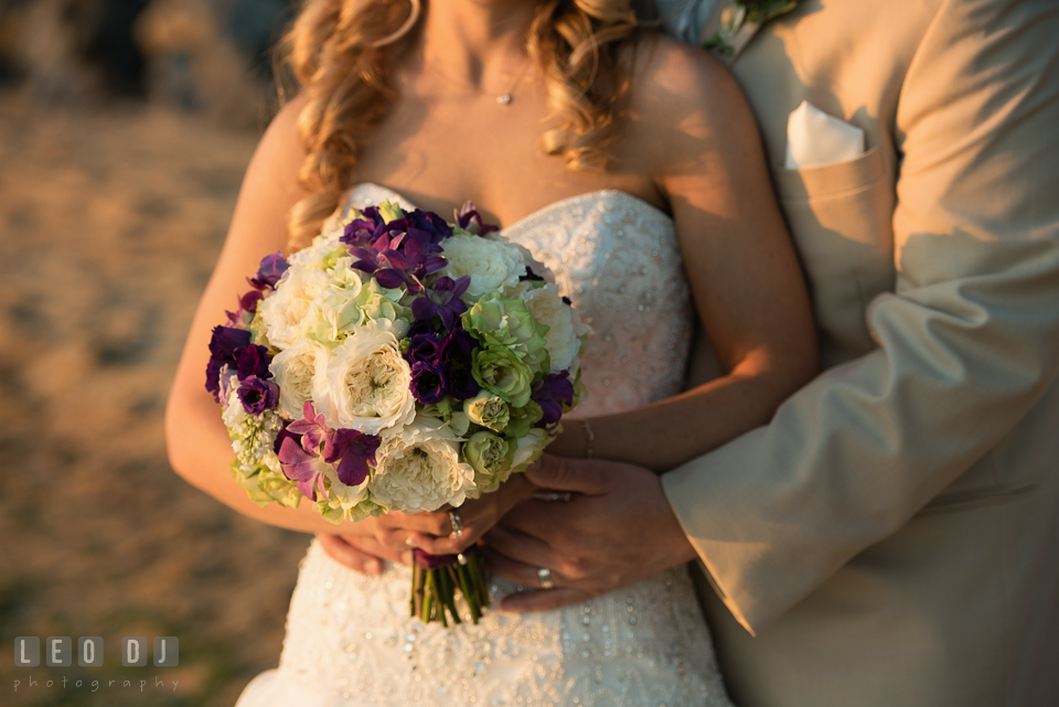 Large bouquet of white and green roses with purple orchids flower for the Bride from florist My Flower Box Events. Kent Island Maryland Chesapeake Bay Beach Club wedding photo, by wedding photographers of Leo Dj Photography. http://leodjphoto.com