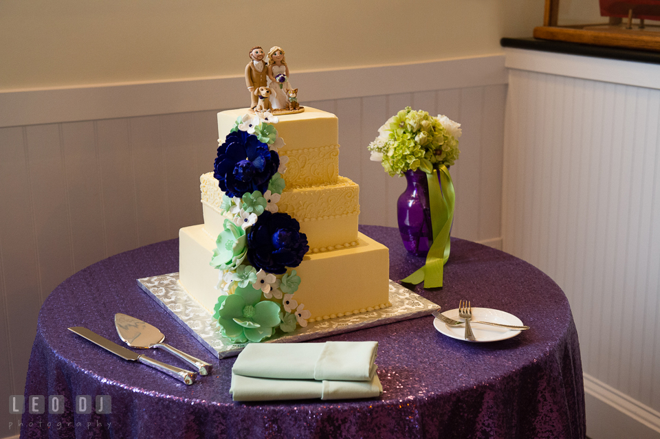 Three-tier cake from Sugar Bakers Cakes with cute cake topper from Trina's Clay Creations. Kent Island Maryland Chesapeake Bay Beach Club wedding photo, by wedding photographers of Leo Dj Photography. http://leodjphoto.com