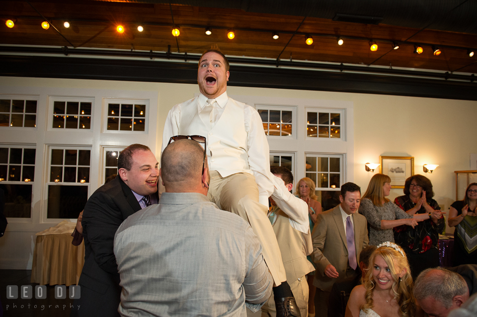 During Horah dance Groom was sat on the chair and lifted up high. Kent Island Maryland Chesapeake Bay Beach Club wedding photo, by wedding photographers of Leo Dj Photography. http://leodjphoto.com
