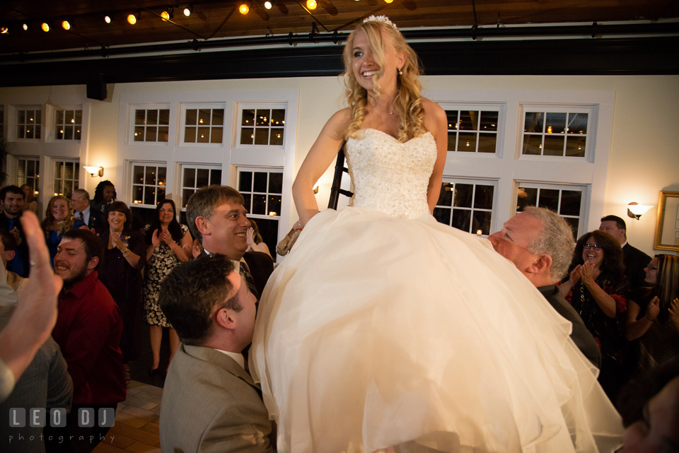 During Horah dance Bride was sat on the chair and lifted up high. Kent Island Maryland Chesapeake Bay Beach Club wedding photo, by wedding photographers of Leo Dj Photography. http://leodjphoto.com