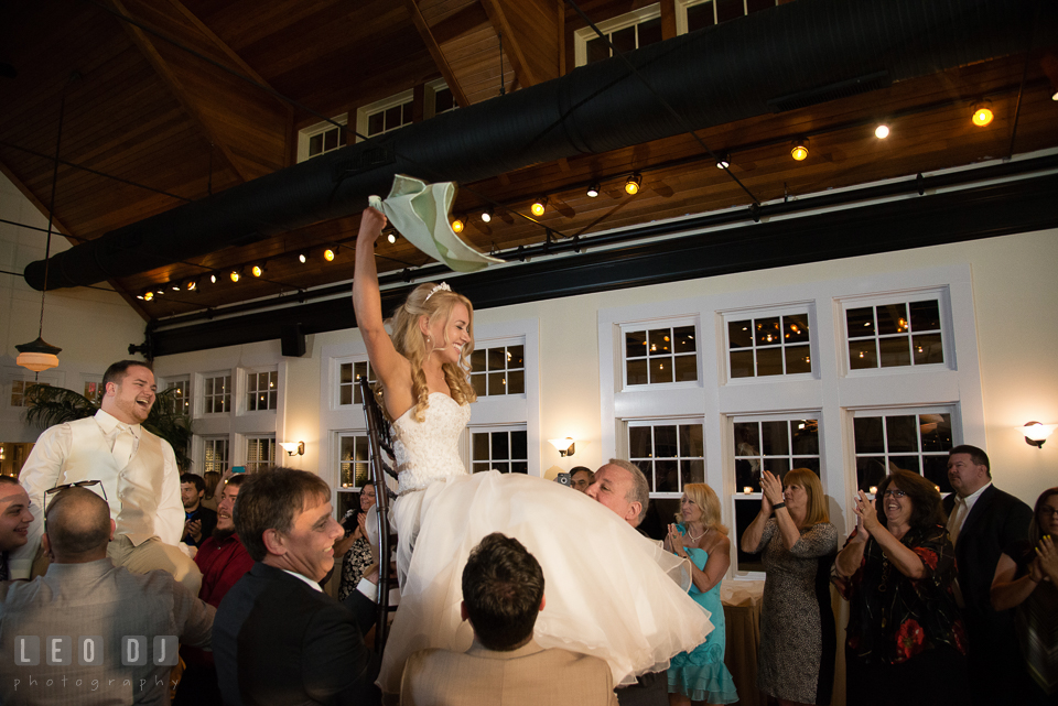 During Horah dance Bride and Groom were sat on the chair and lifted up high. Kent Island Maryland Chesapeake Bay Beach Club wedding photo, by wedding photographers of Leo Dj Photography. http://leodjphoto.com