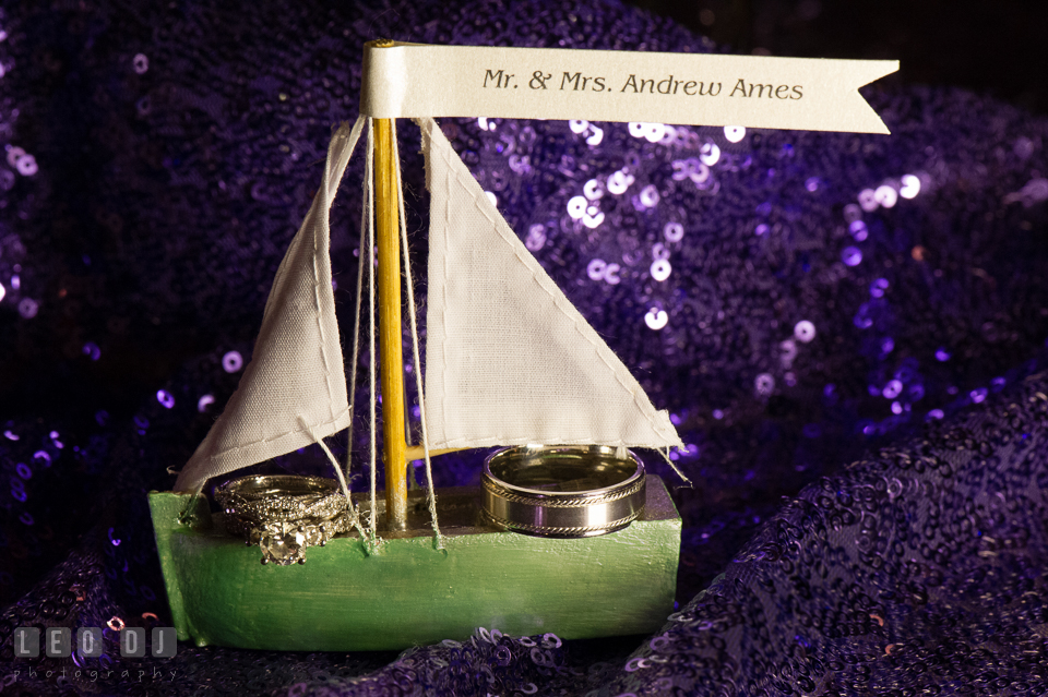 Bride and Groom's engagement and wedding rings on a small sail boat. Kent Island Maryland Chesapeake Bay Beach Club wedding photo, by wedding photographers of Leo Dj Photography. http://leodjphoto.com