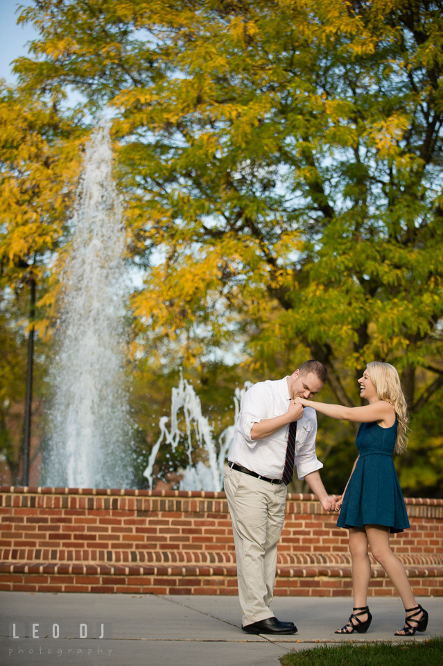 Engaged man kissed his fiancée's hand by the water fountain. Gettysburg PA pre-wedding engagement photo session, by wedding photographers of Leo Dj Photography. http://leodjphoto.com