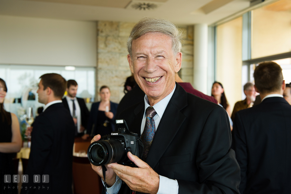 Father of the Groom likes to take pictures. Landgrafen Restaurant, Jena, Germany, wedding reception and ceremony photo, by wedding photographers of Leo Dj Photography. http://leodjphoto.com