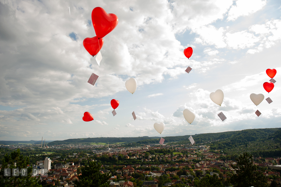 Heart-shaped balloons in the sky with written postcards for the Bride and Groom. Landgrafen Restaurant, Jena, Germany, wedding reception and ceremony photo, by wedding photographers of Leo Dj Photography. http://leodjphoto.com