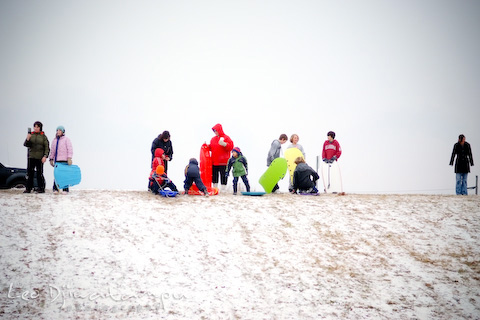 Children playing sled at K-Mart Stevensville Park and Ride during snow day