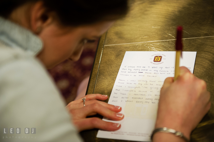 Bride writing vow for ceremony. Historic Inns of Annapolis, Governor Calvert House wedding Maryland, by wedding photographers of Leo Dj Photography. http://leodjphoto.com