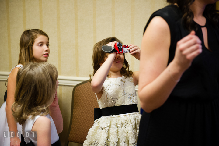 Flower girl trying to take video of Bride getting ready. Historic Inns of Annapolis, Governor Calvert House wedding Maryland, by wedding photographers of Leo Dj Photography. http://leodjphoto.com
