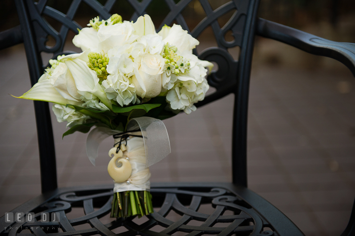 Bride's white flower bouquet attached with her late Grandmother's necklace. Historic Inns of Annapolis, Governor Calvert House wedding Maryland, by wedding photographers of Leo Dj Photography. http://leodjphoto.com