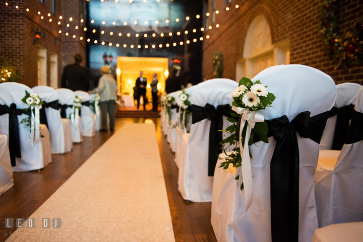 Chairs at ceremony site decorated with ribbons and flowers. Historic Inns of Annapolis, Governor Calvert House wedding Maryland, by wedding photographers of Leo Dj Photography. http://leodjphoto.com