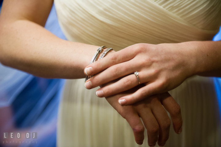 Bride putting on her bracelets. Historic Inns of Annapolis, Governor Calvert House wedding Maryland, by wedding photographers of Leo Dj Photography. http://leodjphoto.com