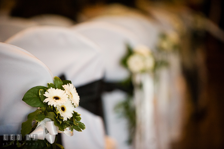 Close up shot of flower decoration for chairs at the ceremony site. Historic Inns of Annapolis, Governor Calvert House wedding Maryland, by wedding photographers of Leo Dj Photography. http://leodjphoto.com