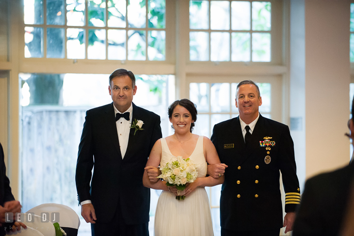 Bride walking down the aisle during procession, escorted by both of her Uncles. Historic Inns of Annapolis, Governor Calvert House wedding Maryland, by wedding photographers of Leo Dj Photography. http://leodjphoto.com