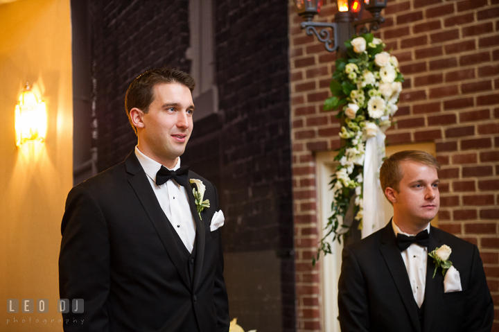 Groom emotional seeing Bride for the first time in her wedding dress during procession. Historic Inns of Annapolis, Governor Calvert House wedding Maryland, by wedding photographers of Leo Dj Photography. http://leodjphoto.com
